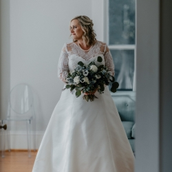 Bride poses among the rooms of Ritchie Hill for Candle and Quill Photography