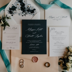 Unique wedding invitation suite feature a fun contrast in color making the perfect pop