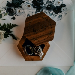 Bride jewelry placed in a vintage wooden box are beautifully captured by Candle and Quill Photography