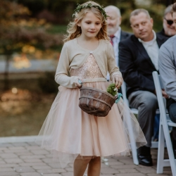 Sweet flower girl throws out petals during a wedding ceremony at Ritchie Hill coordinated by Magnificent Moments Weddings