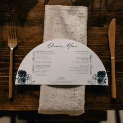 Custom menu cards and gold flatware were amazing additions to a fall wedding at Ritchie Hill