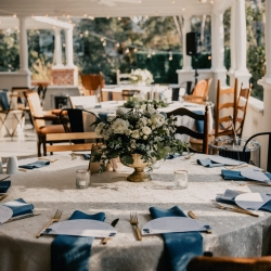 Ritchie Hill wedding featured lush linens and blue napkins from Party Reflections as well as vintage chairs rented from Prettiest Pieces