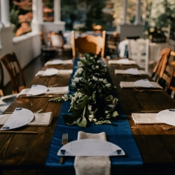 Rustic farm house tables and mismatched chairs from Prettiest Pieces were the perfect accent to a fall wedding at Ritchie Hill