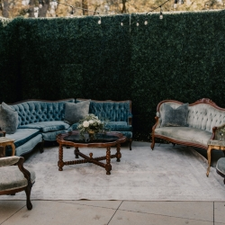 Vintage furniture from Prettiest Pieces created a great sitting area for a fall wedding at Ritchie Hill