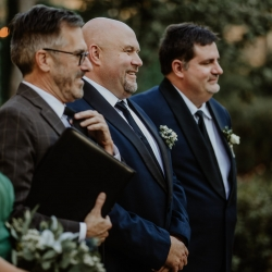 Candle and Quill Photography captures the grooms reaction as he watches his bride walk down the aisle