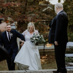Brides son helps escort her mother to her father during a sweet family moment at Ritchie Hill