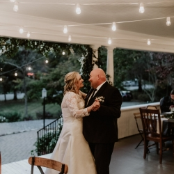 Bride and groom share a romantic first dance during their fall wedding coordinated by Magnificent Moments Weddings