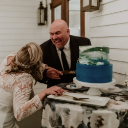 Bride and groom share a laugh as they cut their stunning two tiered cake created by Wentworth and Fenn