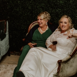 Bride has fun mingling with guests in her fun sitting area with amazing couches from Prettiest Pieces