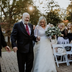Bride was escorted down the aisle by her father during her fall wedding ceremony coordinated by Magnificent Moments Weddings