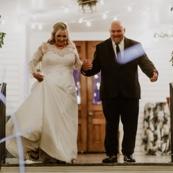 Bride and groom exited their wedding through a seas of glow sticks in a grand exit coordinated by Magnificent Moments Weddings