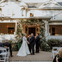 The steps of the historic Ritchie Hill home was covered in a stunning greenery arch by Heatherly Event and Floral Design