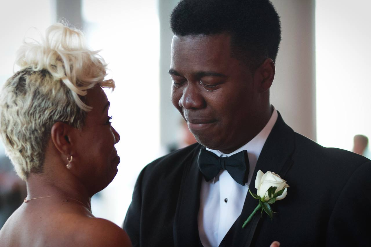 Mother son dance with the groom crying.