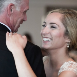 Father daughter dance with bride laughing.