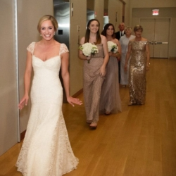Bridal party getting ready to walk down the aisle at the Mint Museum Uptown.