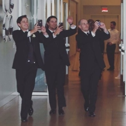 Groomsmen being announced into the reception at the Mint Museum Uptown.