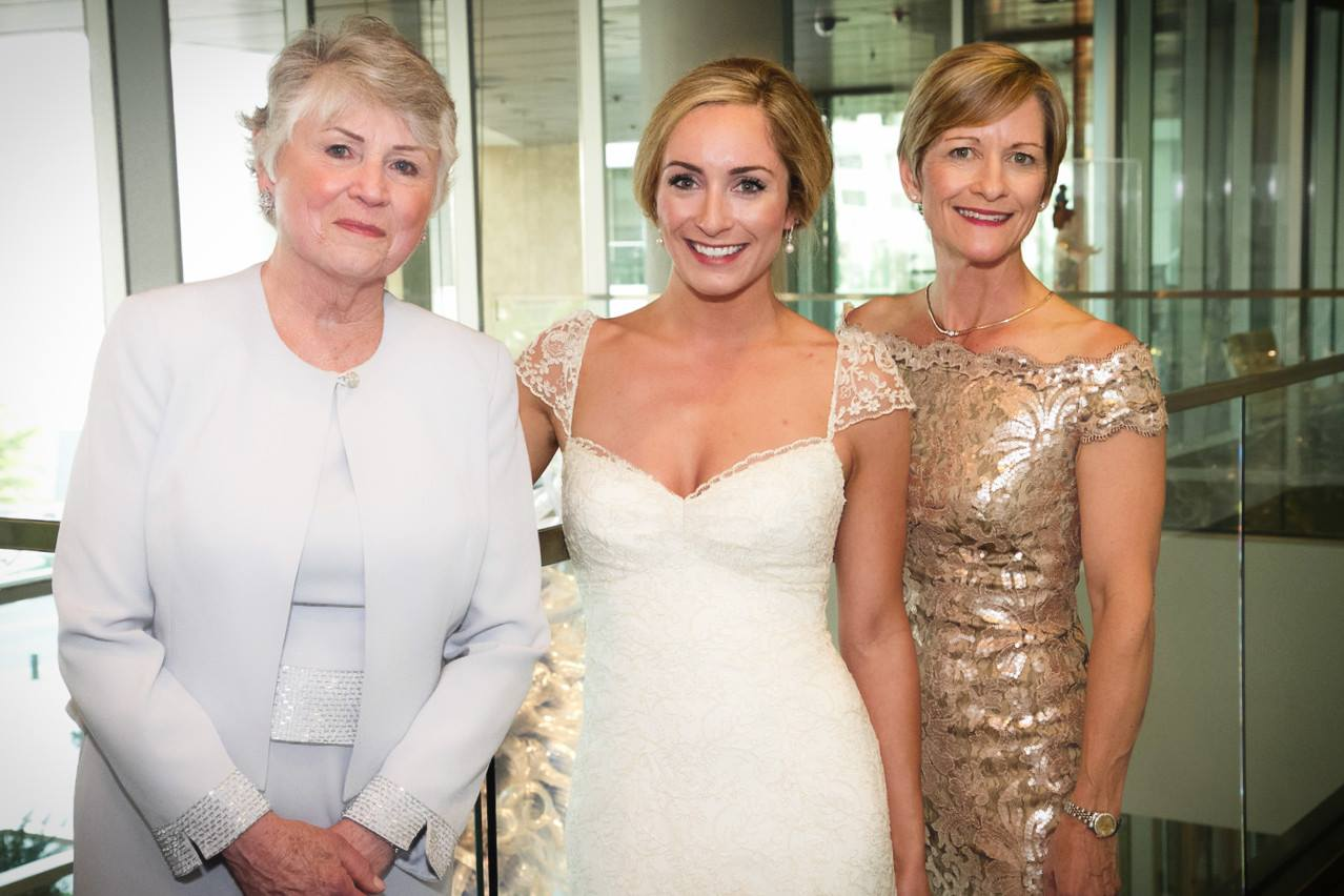 Sweetheart neckline bridal gown with a gold boatneck mother of the bride dress.