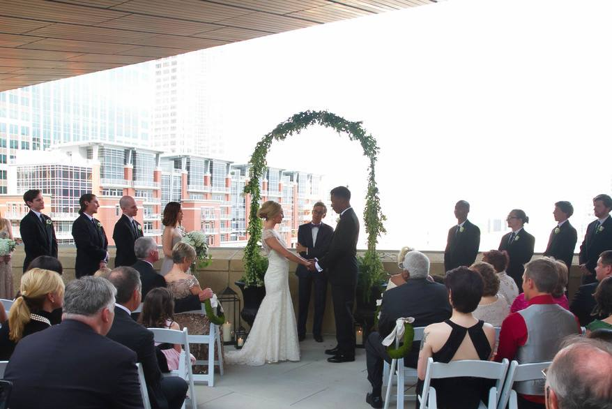 Wedding ceremony on the balcony at the Mint Museum Uptown.