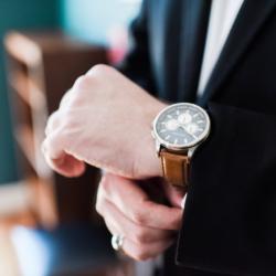 groom adjusting his watch for his wedding