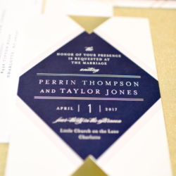 wedding invitation with navy and gold