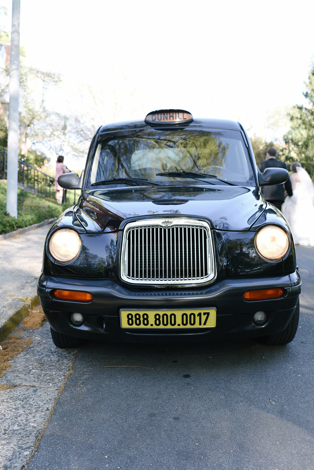Dunhill taxi taking the bride and groom from the ceremony to the reception