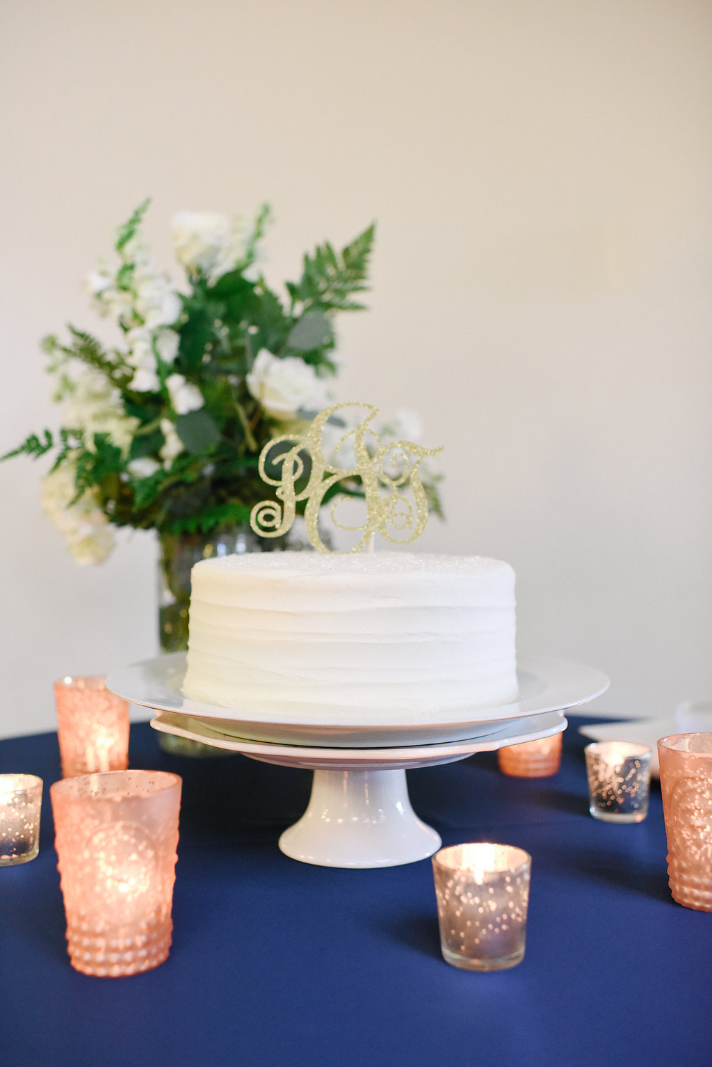 wedding cake with initial gold sparkly cake topper