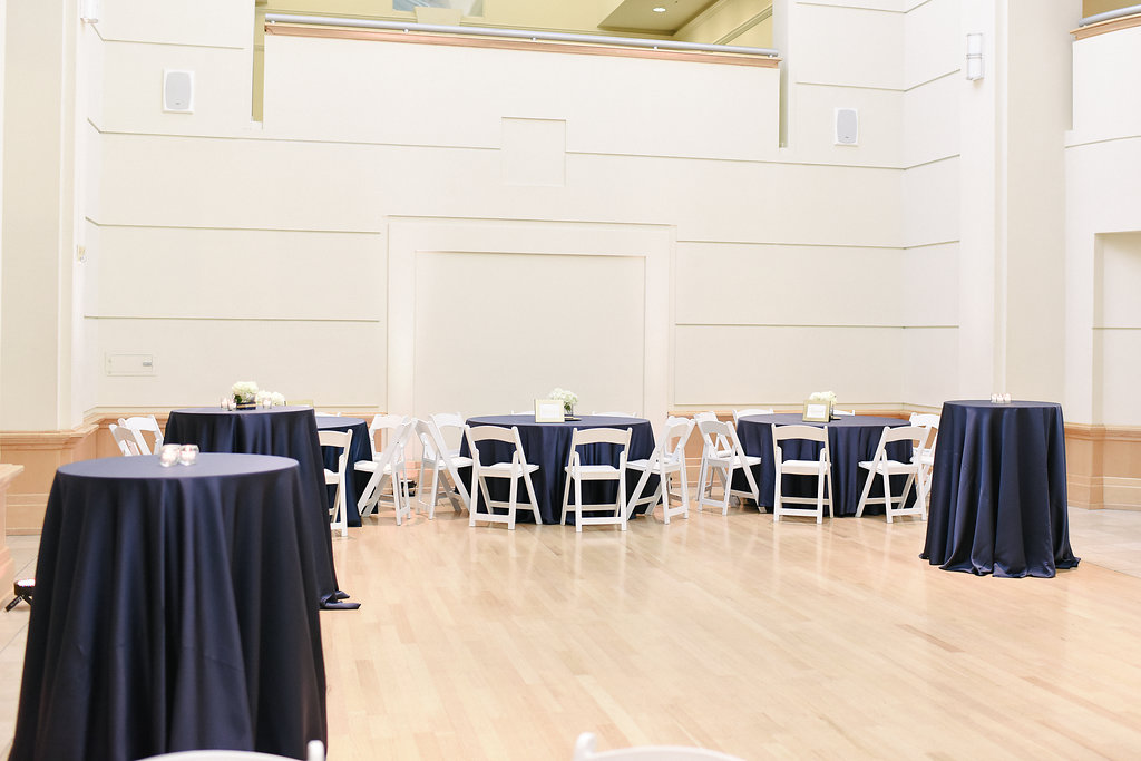Navy linens setup for a wedding at the Levine Museum of the New South.