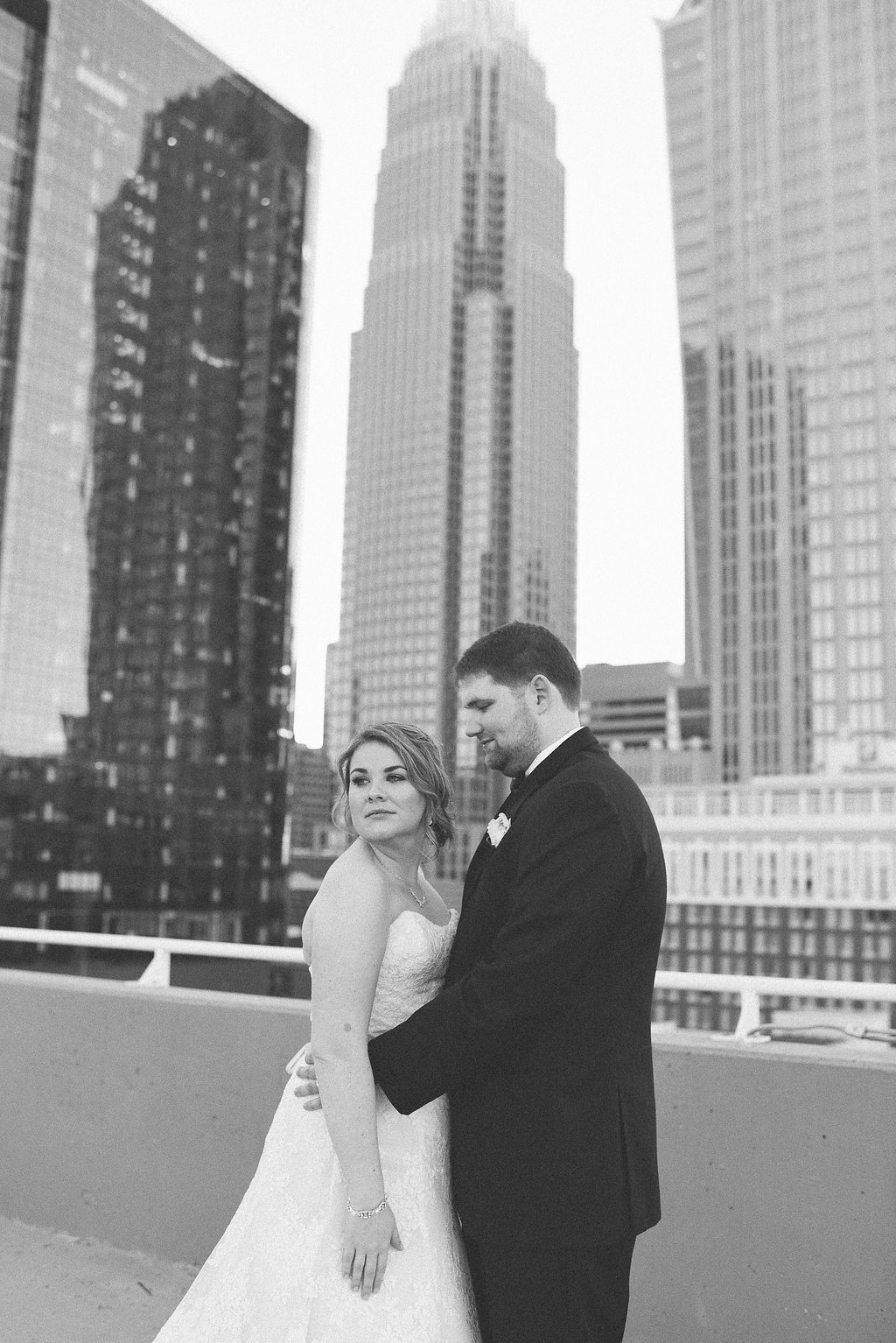 Bride and groom portraits with the Charlotte skyline as the background