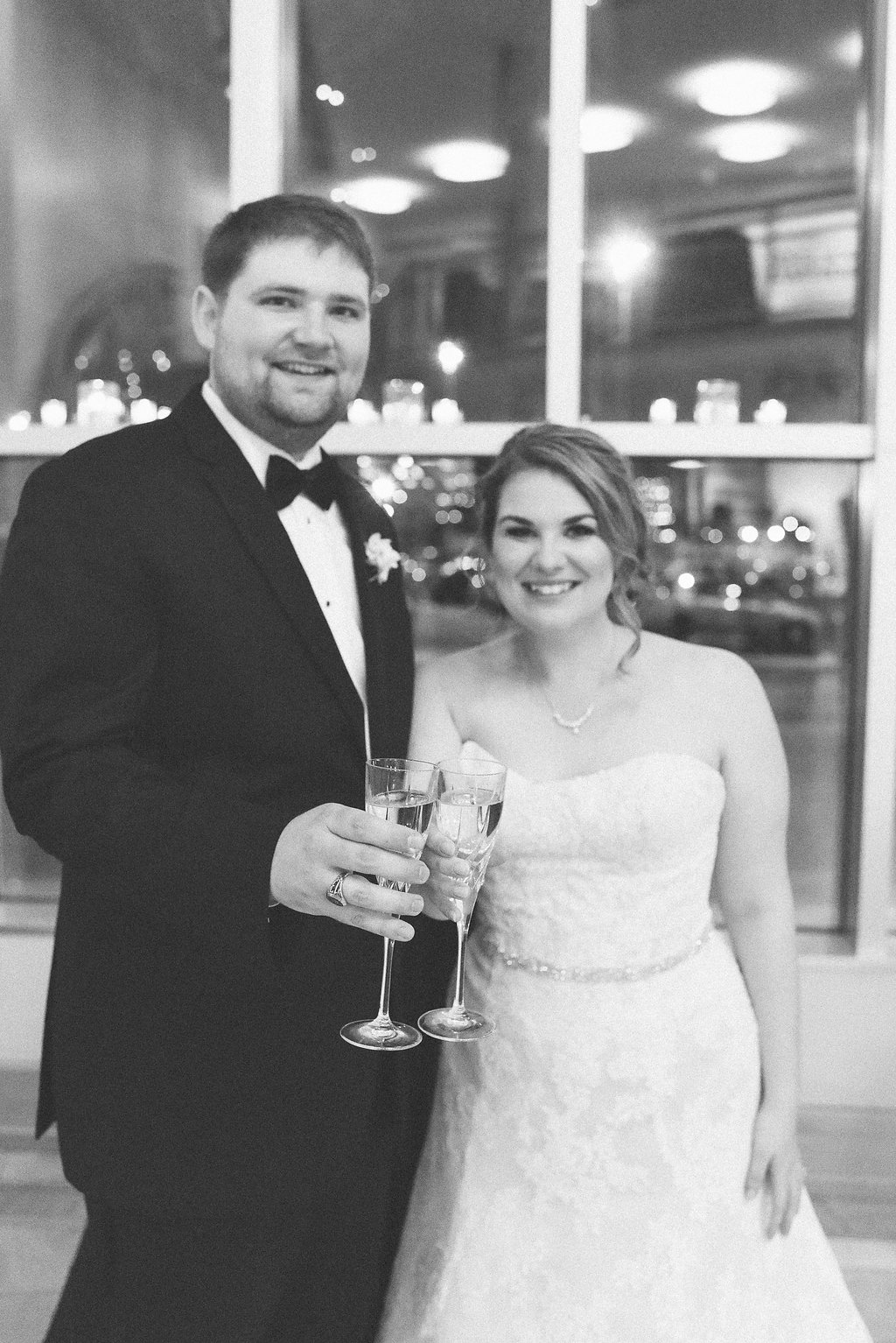 bride and groom toasting champagne at the Levine Museum of the New South
