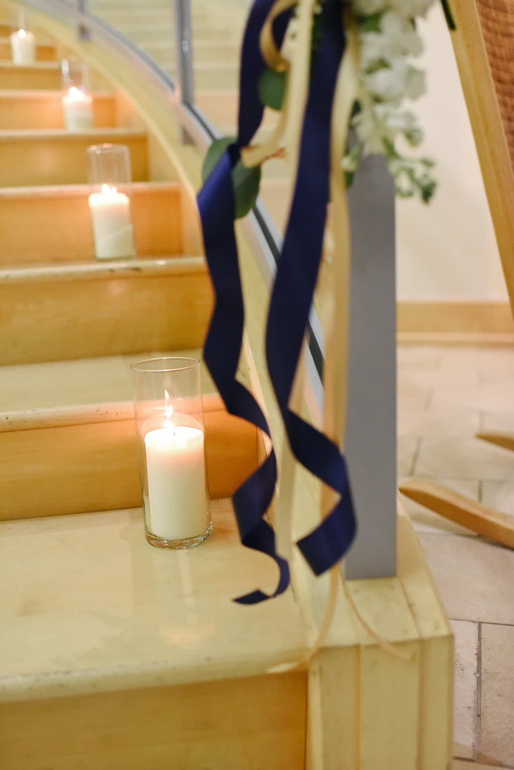pillar candles lining the staircase at the Levine Museum of the New South