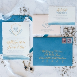 Invitation suite with deep french blue details and accents of gold lettering created by Ocean and Coral Creative