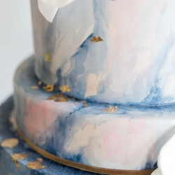 Amazing blue marbled cake with delicate gold leaf by Sky's the Limit Bridal Sweets