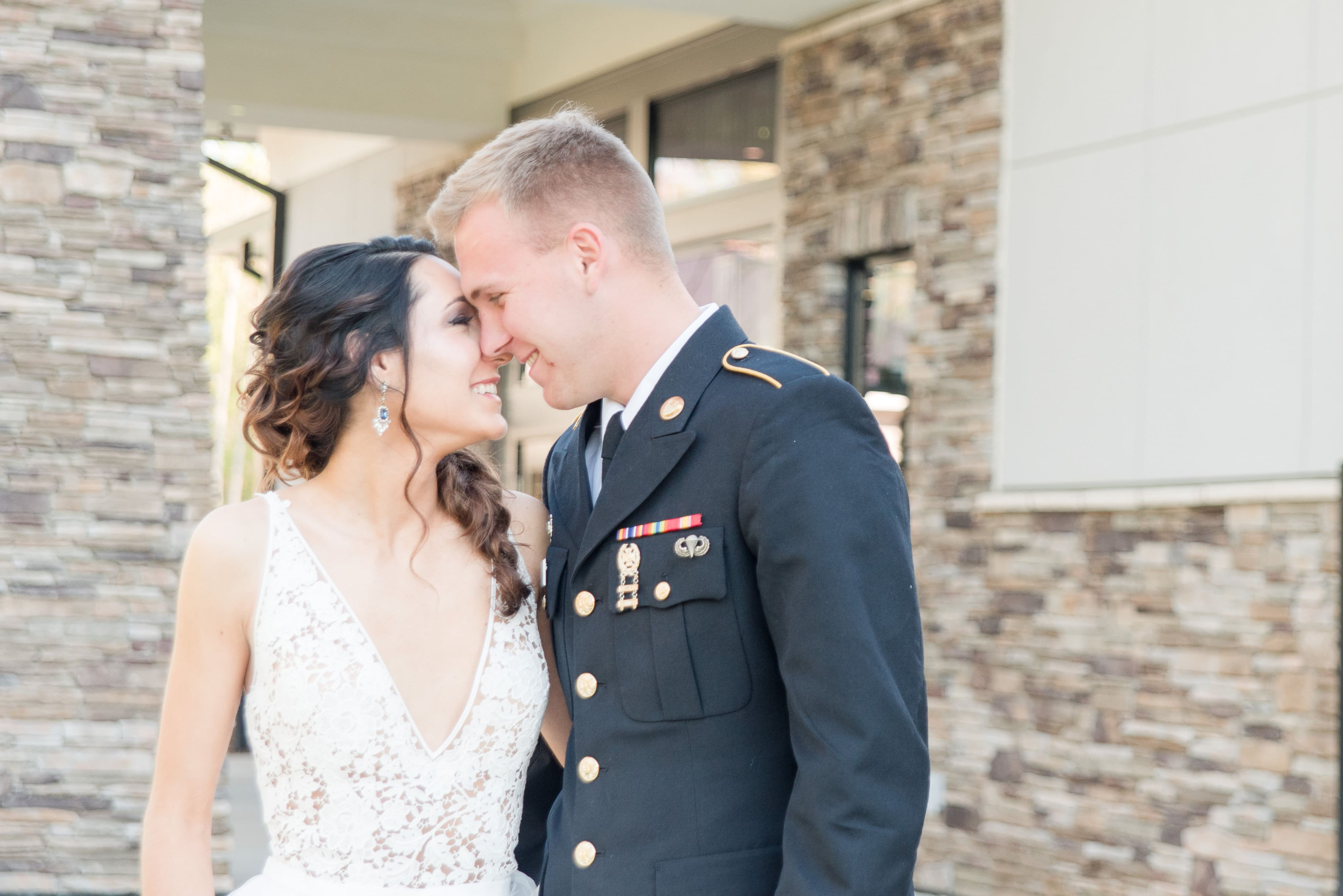 Bride wearing a dress by J Majors embraces groom in image captured by Charlotte Wedding Collective
