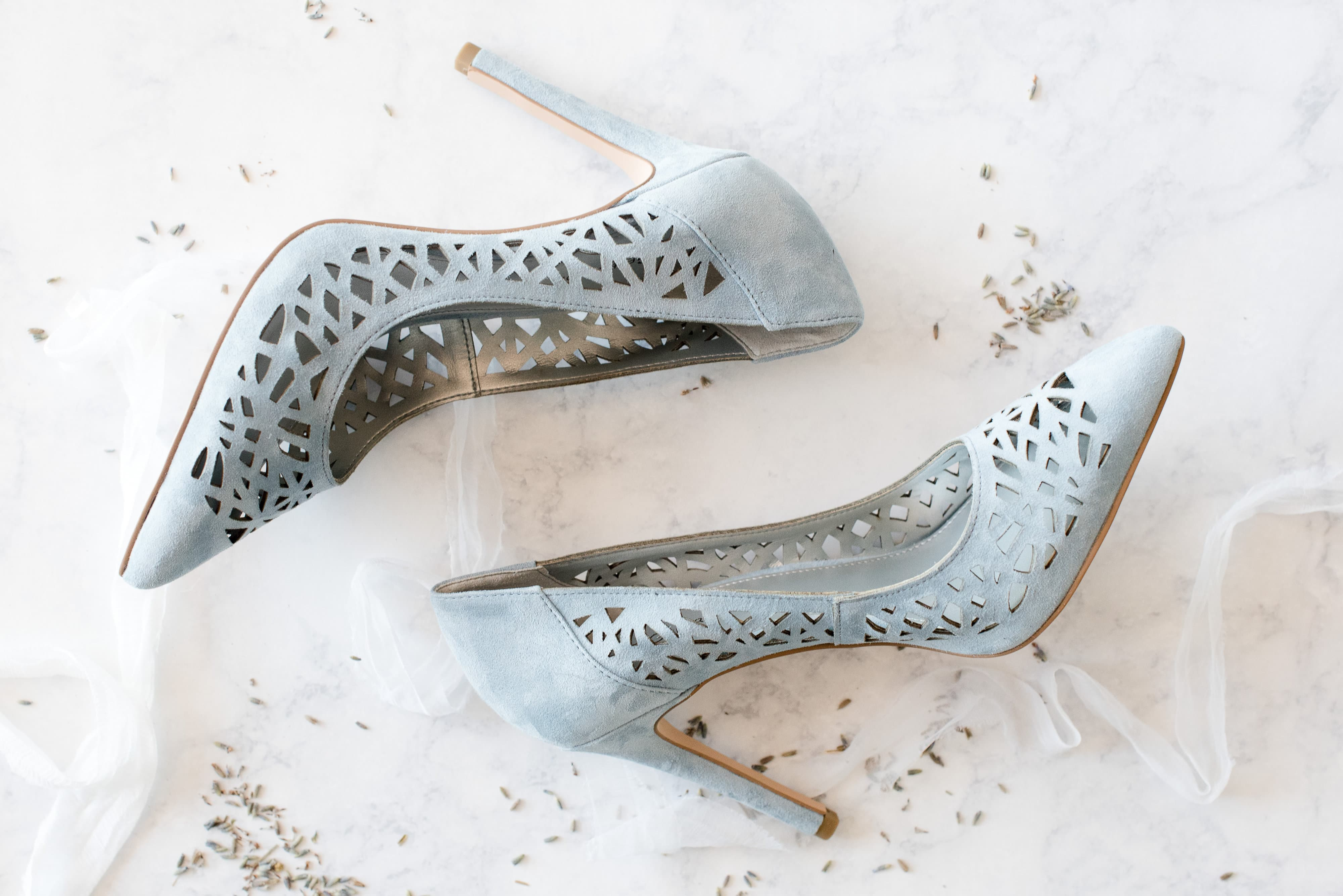 Blue bridal shoes captured by Charlotte Wedding Collective