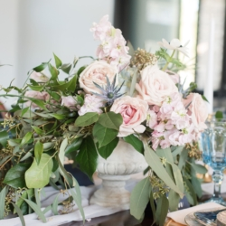 Pink rose center piece accents with blue florals designed by Magnificent Moments Weddings