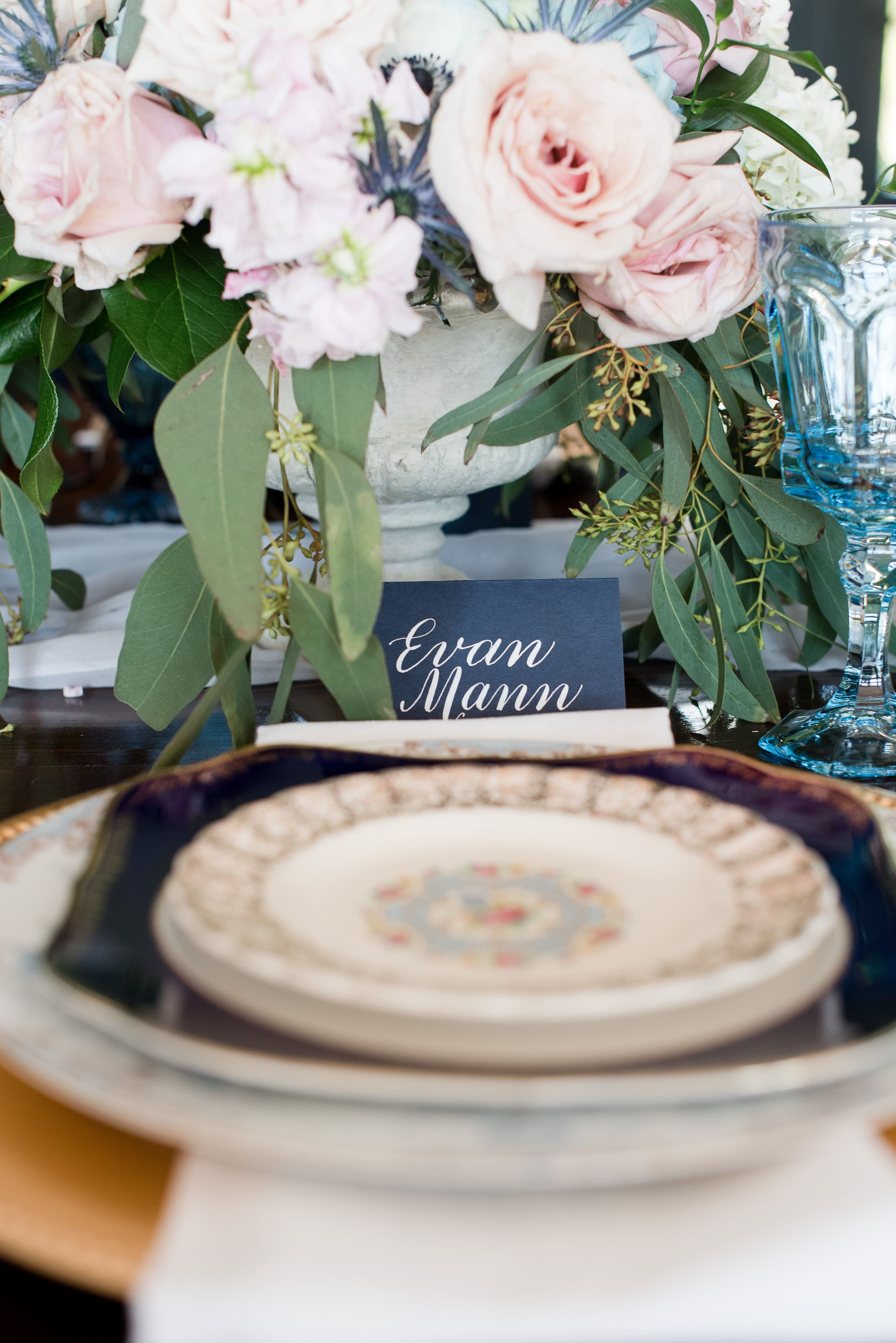 French blue place setting complete with navy place card and vintage china captured by Charlotte Wedding Collective