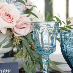 Vintage blue glasses show a elegant french theme rented from Evermore Events