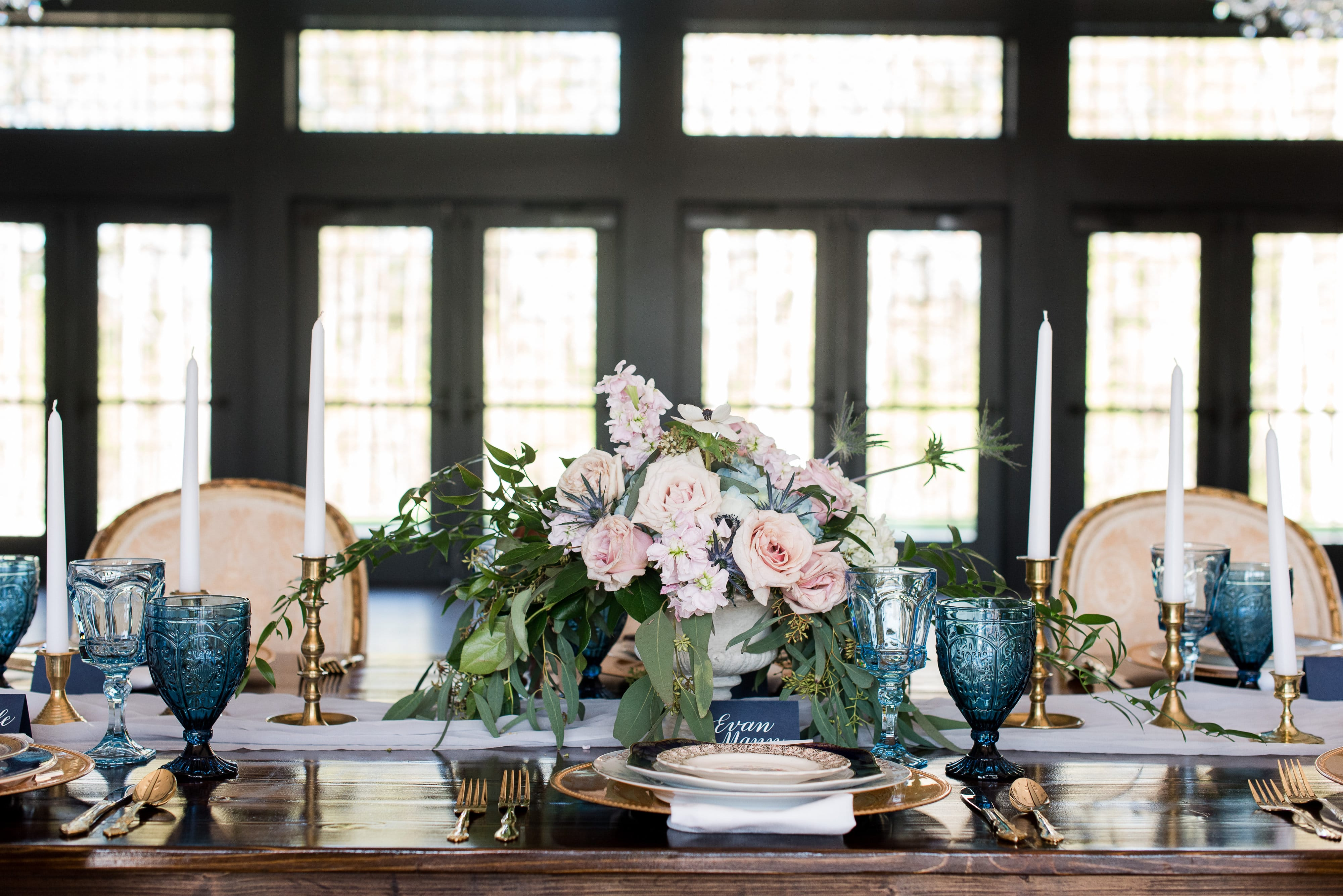Amazing french blue table setting with pink roses and blue accents created by Magnificent Moments Weddings