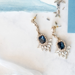Detail shot of beautiful blue earrings captured by Charlotte Wedding Collective