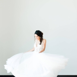 Bride twirls in dress by J Majors