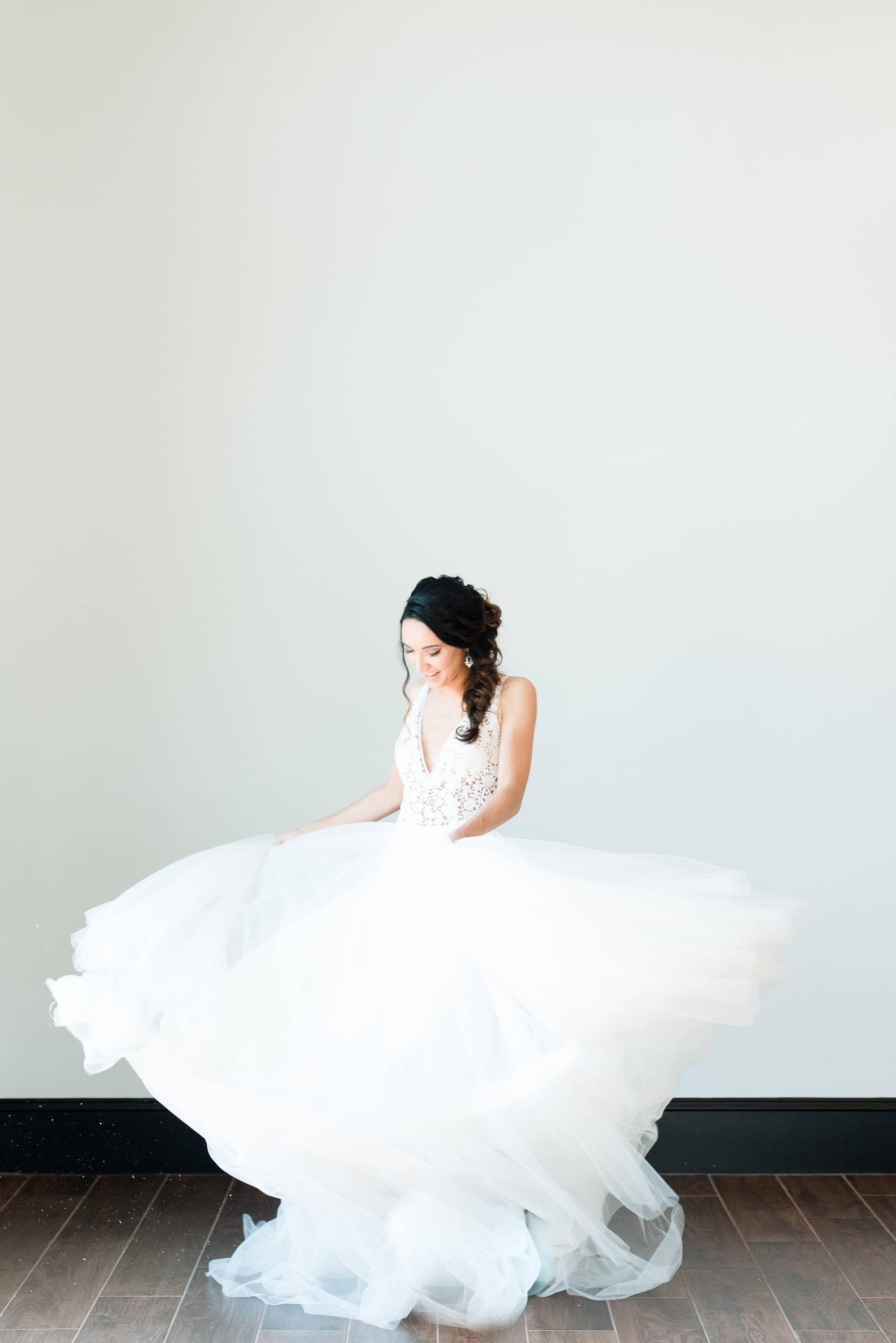 Bride twirls in dress by J Majors