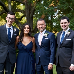 Groom poses with his family for Critsey Rowe Photography during his wedding in Charlotte, North Carolina