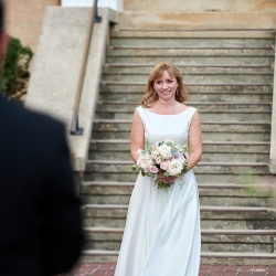 Bride walks down the aisle to meet her groom during her wedding captured by Critsey Rowe Photography