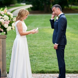 Bride and groom share their own vows during a touch ceremony planned by Magnificent Moments Weddings