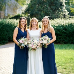 Bride and her family share a sweet moment before her wedding coordinated by Magnificent Moments Weddings