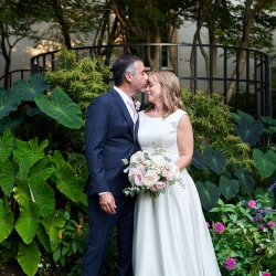 Bride and groom share a sweet moment captured by Critsey Rowe Photography for a wedding at The Mint Museum Uptown