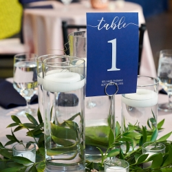Simple table numbers featured a deep blue accent for a wedding in Charlotte, North Carolina captured by Critsey Rowe Photography