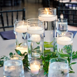 Floating candles and delicate greenery are the perfect centerpieces for a wedding at The Mint Museum Randolph