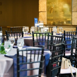 Black chavari chairs, white linens, and blue napkins created a sweet modern vibe for a wedding at The Mint Museum Randolph