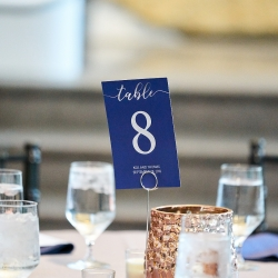 Accents of blue were a sweet touch to a wedding in Charlotte, North Carolina including this table numbers